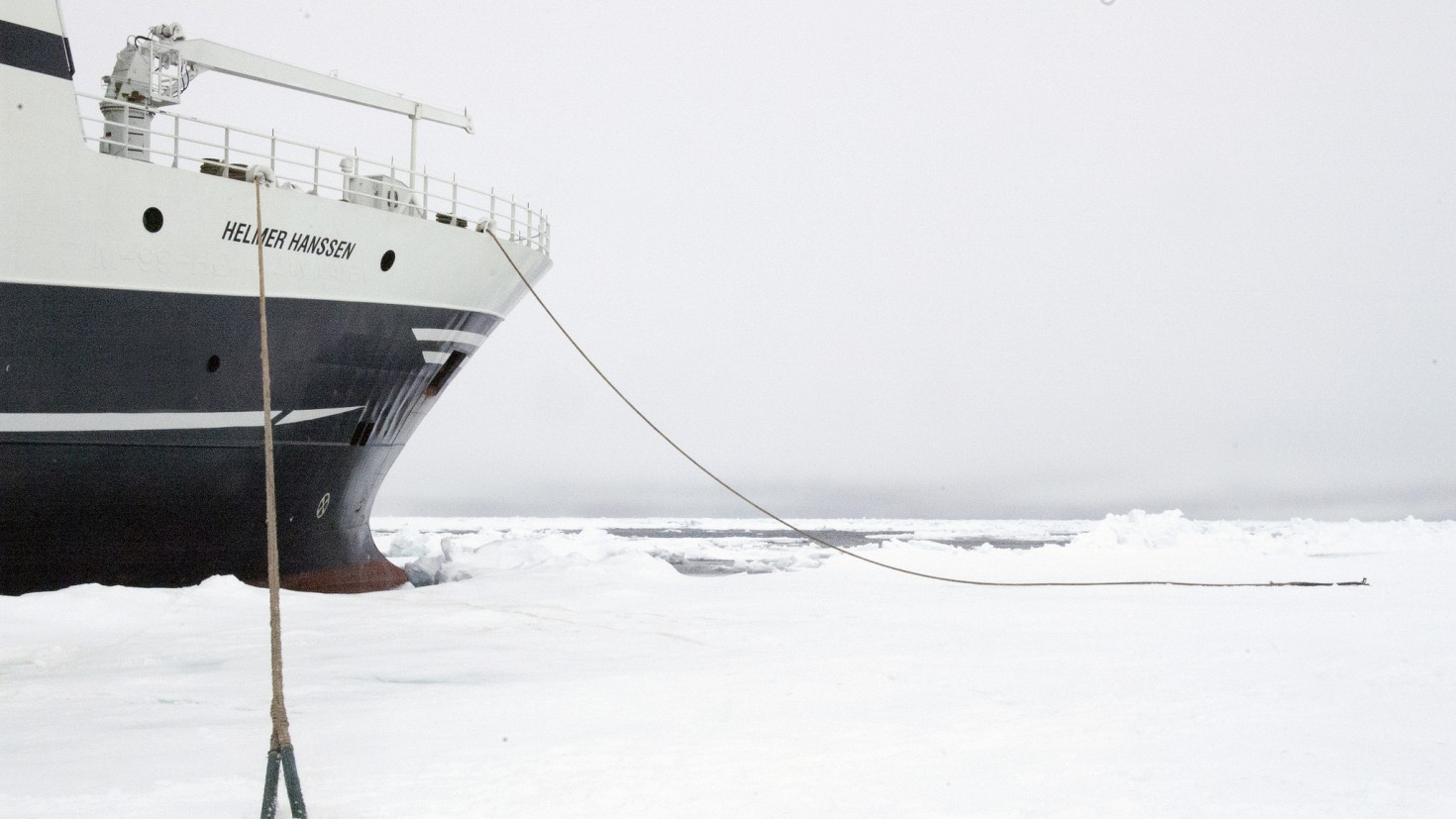 research vessel helmer hanssen moored to the ice edge. Photo: Karine Nigar Aarskog / UiT